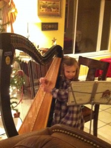 Faith practicing her harp