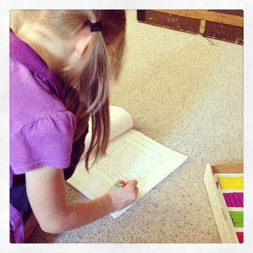 Faith working on her math.